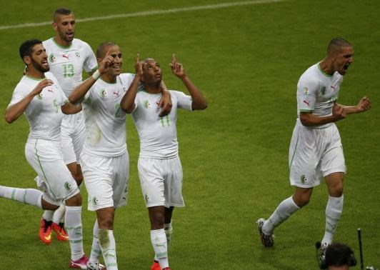 Algeria's Yacine Brahimi (2nd R) celebrates scoring his team's fourth goal against South Korea with teammates during their 2014 World Cup Group H soccer match at the Beira Rio stadium in Porto Alegre June 22. Photo credit: Reuters