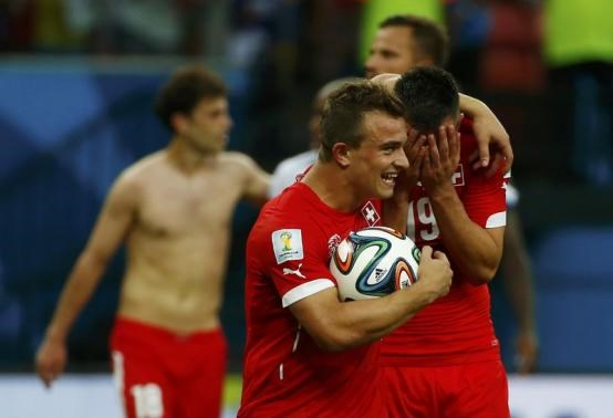 Switzerland's Xherdan Shaqiri (L) celebrates with Josip Drmic after they won Honduras in their 2014 World Cup Group E soccer match at the Amazonia arena in Manaus June 25. Photo credit: Reuters