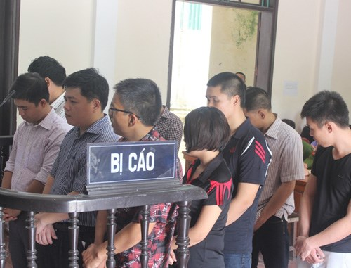 The defendants standing trial for causing the death of Nguyen Quang Hanh on January 21, 2013. Photo: Duc Ngoc