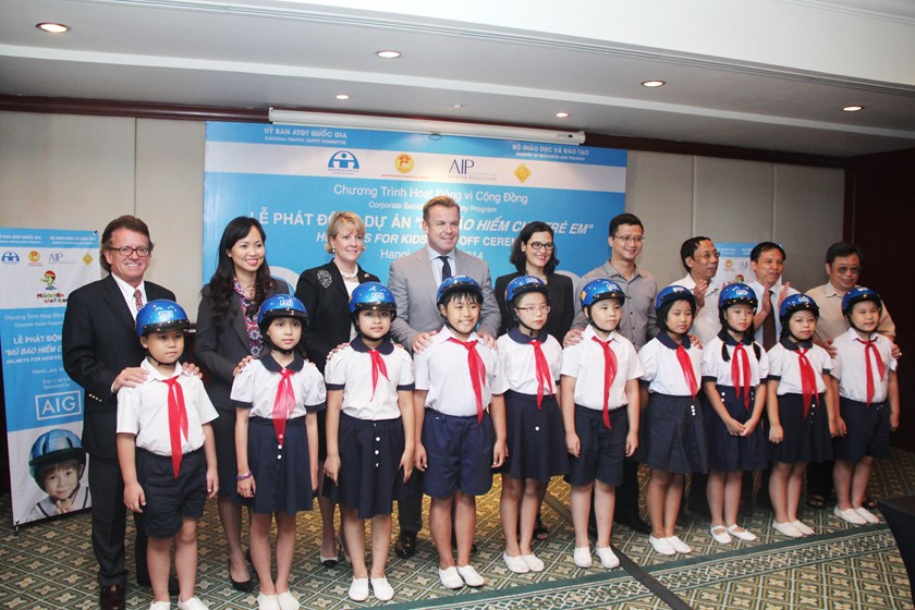 Children at the Trung Vuong Primary School in Hanoi receive helmets donated by Asia Injury Prevention Foundation's Helmets for Kids program. Photo credit: AIP Foundation.