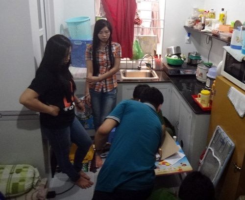 Police arrest suspects in a major online football betting ring on Thursday. Photo: Hoai Nam