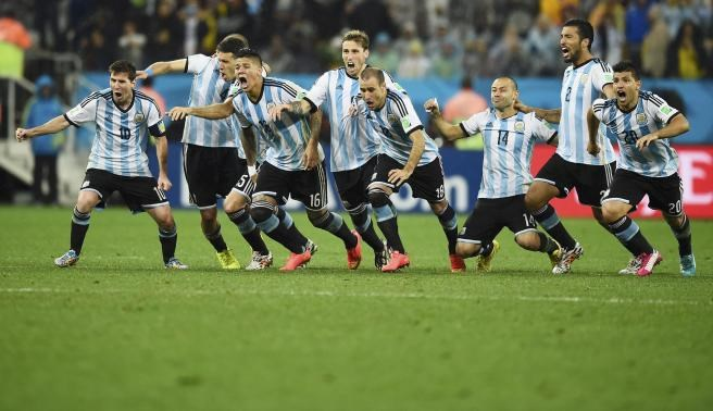 Argentina's national soccer players celebrate after their teammate Maxi Rodriguez scored the decisive goal during a penalty shoot-out against the Netherlands at their 2014 World Cup semi-finals at the Corinthians arena in Sao Paulo July 9. Photo credit: