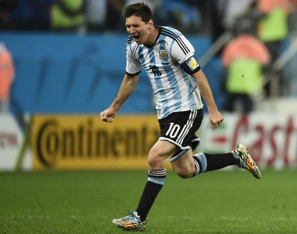 Argentina's Lionel Messi celebrates after his teammate Maxi Rodriguez scores the winning goal against Netherlands during a penalty shootout in their 2014 World Cup semi-finals at the Corinthians arena in Sao Paulo July 9. Photo credit: Reuters