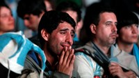 Argentina's fans react after Argentina lost to Germany in their 2014 World Cup final soccer match in Brazil, at a public square viewing area in Buenos Aires July 13. Photo credit: Reuters