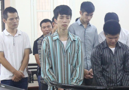 The defendants stand trial for hacking credit card information at the Hanoi People's Court on July 14. Photo credit: VnExpress
