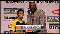 Nguyen Tien Minh (L) on the podium at the 2014 US Open Badminton Championships. Still image captured from TV