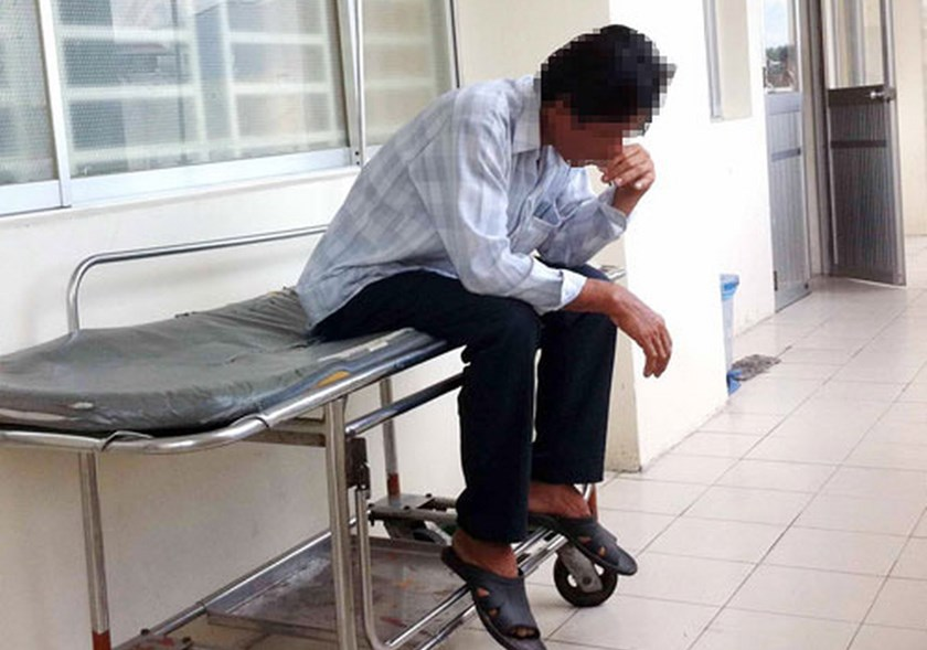 A man smokes at the 115 People's Hospital in Ho Chi Minh City despite a ban against smoking at public places in Vietnam. Cigarette packs without the required graphic warnings are being sold widely in Vietnam. Photo: Doc Lap