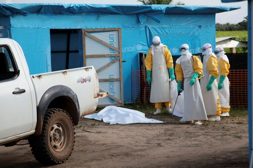 Health workers, wearing head-to-toe protective gear, prepare for work, outside an isolation unit for patients with Ebola virus disease in Foya District, Lofa County, Liberia in this July 2014 UNICEF handout photo. Photo: Reuters