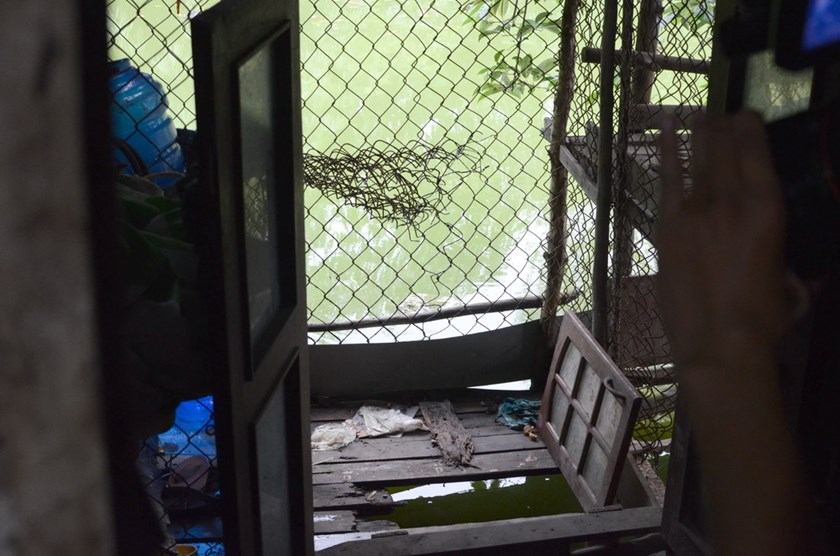 A latrine at the back of a house in Ho Chi Minh City's Le Minh Xuan Commune where local residents dischage waste directly into the water. Photo: Minh Hung