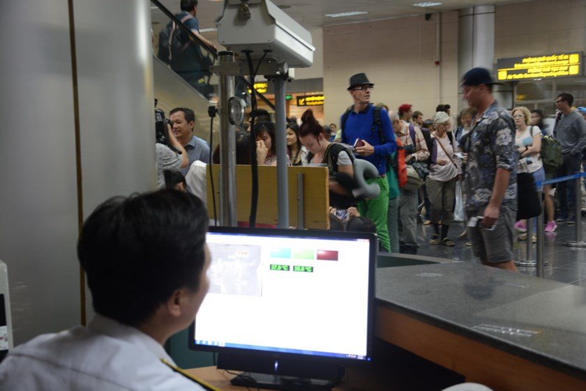 International visitors undergoing temperature screening at an airport in Vietnam. Photo: Thuy Anh