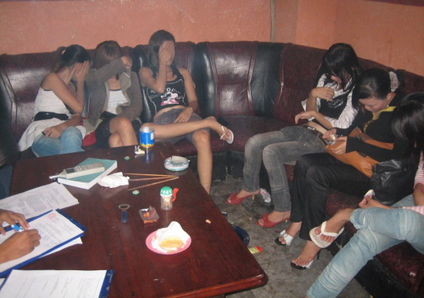 Sex workers being caught at a karaoke parlor in Ho Chi Minh City. Photo: Vy Anh