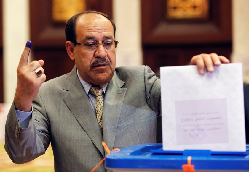 Iraq's Prime Minister Nouri al-Maliki casts his ballot during parliamentary election in Baghdad in this April 30, 2014 file photo. Photo credit: Reuters