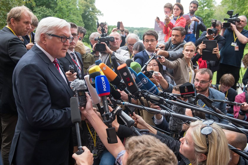 German Foreign Minister Frank-Walter Steinmeier speaks to journalists prior to a meeting of foreign ministers of Russia, Ukraine, France on the situation in Ukraine on August 17. Photo credit: AFP