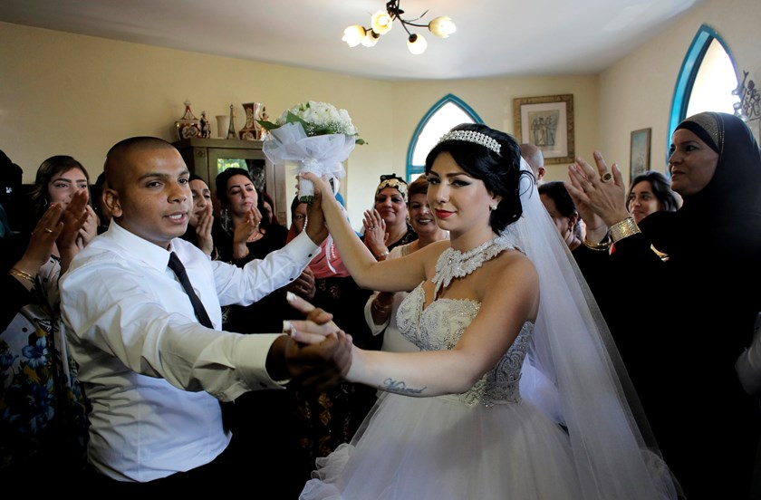 Groom Mahmoud Mansour, 26, and his bride Maral Malka, 23, celebrate with friends and family before their wedding in Mahmoud's family house in Jaffa, south of Tel Aviv August 17. Photo credit: Reuters