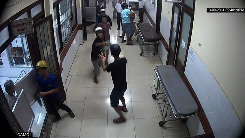 A still shot recorded by a security camera at Dak Lak General Hospital of two gangs fighting on August 13, 2014