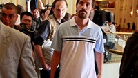 U.S. journalist James Foley (R) arrives with fellow reporter Clare Gillis (not pictured), after being released by the Libyan government, at Rixos hotel in Tripoli, in this picture taken May 18, 2011. Photo credit: Reuters