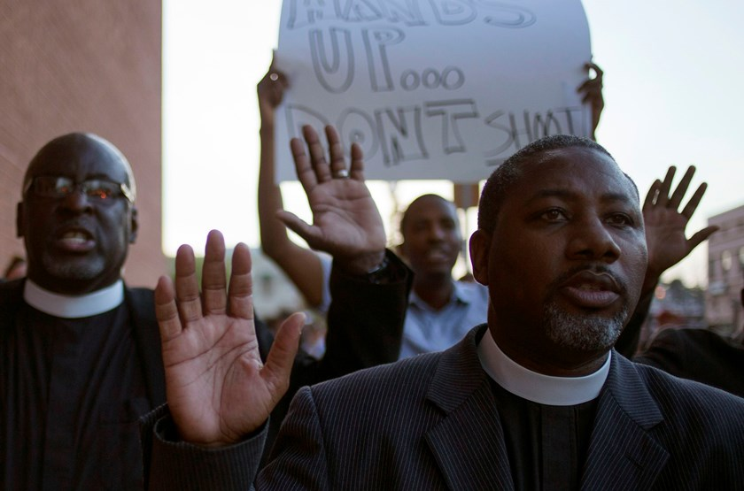 "Clergymen shout ""Hands up, don't shoot,"" as they march to the County Prosecutor Bob McCulloch's office to protest the shooting death of unarmed black teen Michael Brown in Clayton, Missouri August 20. Photo credit: Reuters"
