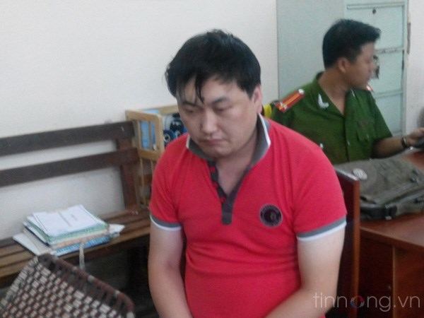 Ly Shi Min was arrested for alleged phone fraud. Photo: Bao Thien