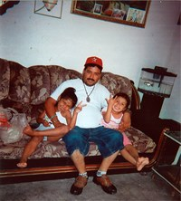 Guillermo Arevalo Pedraza (C) sits with his daughters in an undated photo released by his family in Nuevo Laredo, Mexico. The family of a Mexican man they said was shot dead by U.S. agents on the Mexican side of the border in 2012 filed a lawsuit on Augus
