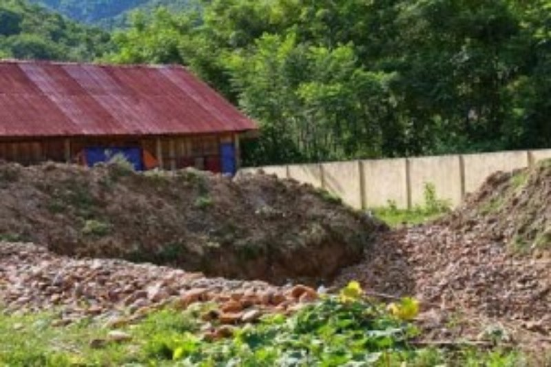 Four deep holes were dug around a district school house by miners searching for gold. Photo credit: Dan Tri