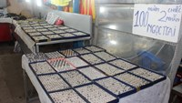 A night market stall on Phu Quoc Islands sells two pearl rings for VND100,000 (US$5). Photo: Tien Trinh
