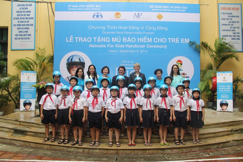 Children at Hanoi's Trung Vuong Primary School receive helmets from the AIP Foundation's Helmets for Kids program. Photo: AIP Foundation