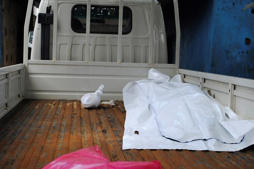 The body of a victim of Ebola virus is seen covered with a sheet at the back of a truck after health workers collected it in Monrovia, Liberia, on September 13. Photo credit: Reuters