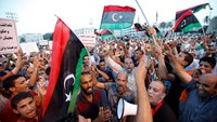Supporters of Operation Dawn, a group of forces mainly from Misrata, demonstrate against and call for the removal of the new Libyan parliament based in the eastern city of Tobruk, the House of Representatives, at Martyrs' Square in Tripoli September 19. P
