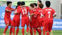 Vietnam's women's footballers celebrates a win against Thailand at the 17th Asian Games. Photo: Ngo Nguyen