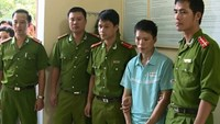 Tran Xuan Trinh (2, R) was arrested after nearly two months hiding. File photo