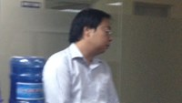 Vu Duc Hieu, director of VGX Company, was arrested on Friday for running an illegal online gold trading services. Photo: Duc Hoa