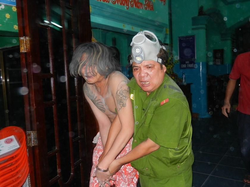 A man was arrested for holding his girlfriend hostage while under the influence of drugs in Ba Ria-Vung Tau Province in 2012. Photo: Nguyen Long