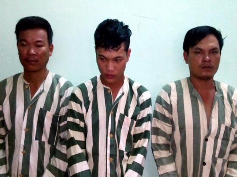 Three of the eight men arrested for beating a dog thief to death in Binh Dinh on September 28, 2014. Photo: Bao Van
