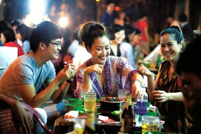 Sidewalk eateries (most of which sell beer) have become a cultural fixture of life in urban Vietnam. Photo: Tran Viet Duc