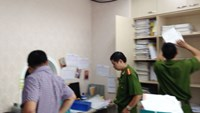 Police raid the offices of Khai Thai Company in Hanoi. Photo: Thai Son