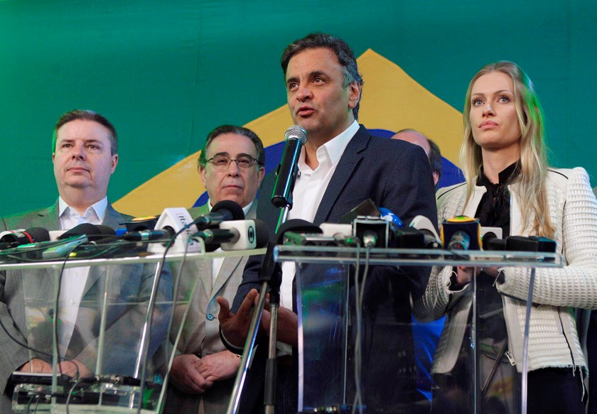 Presidential candidate Aecio Neves of the Brazilian Social Democracy Party (PSDB) gives a news conference after the official vote tally placed him second in the first round election, in Belo Horizonte, October 5. Photo credit: Reuters