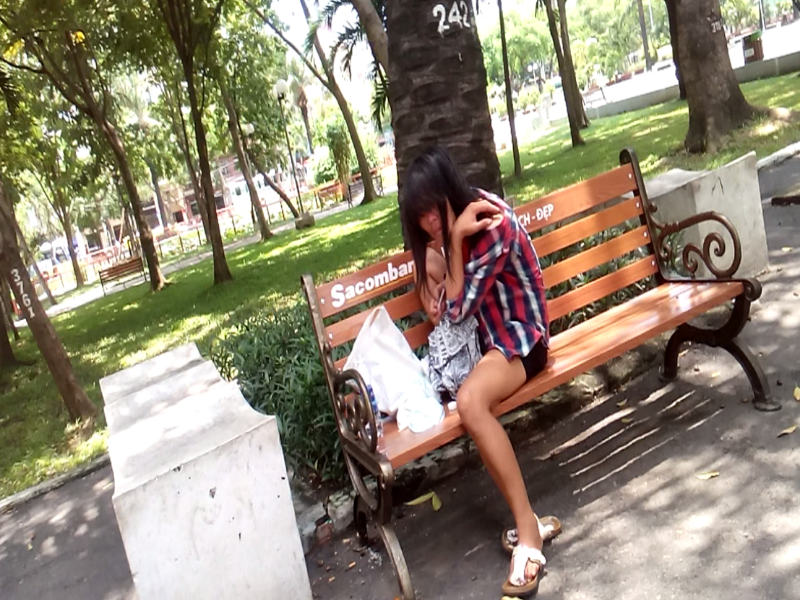 A woman shoots up in a park in downtown Ho Chi Minh City. Photo: Duc Tien
