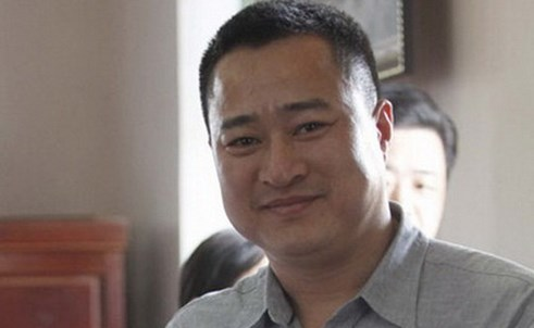 Nguyen Anh Tuan, 43, director of Viet Finance Group, was arrested Tuesday as part of a blackmail investigation. Photo credit: Tien Phong