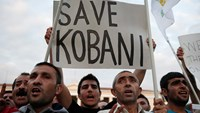 Pro-Kurdiush demonstrators take part in a rally in Athens, in solidarity with the people of Syrian Kurdish town of Kobani, October 8. Photo credit: Reuters