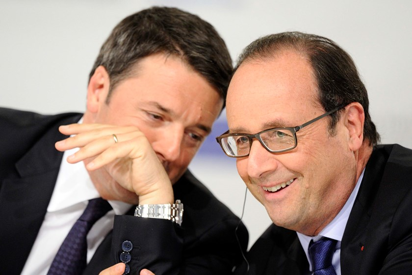 Italy's Prime Minister Matteo Renzi (L) and France's President Francois Hollande talk during a conference on jobs in Milan October 8. Photo credit: Reuters
