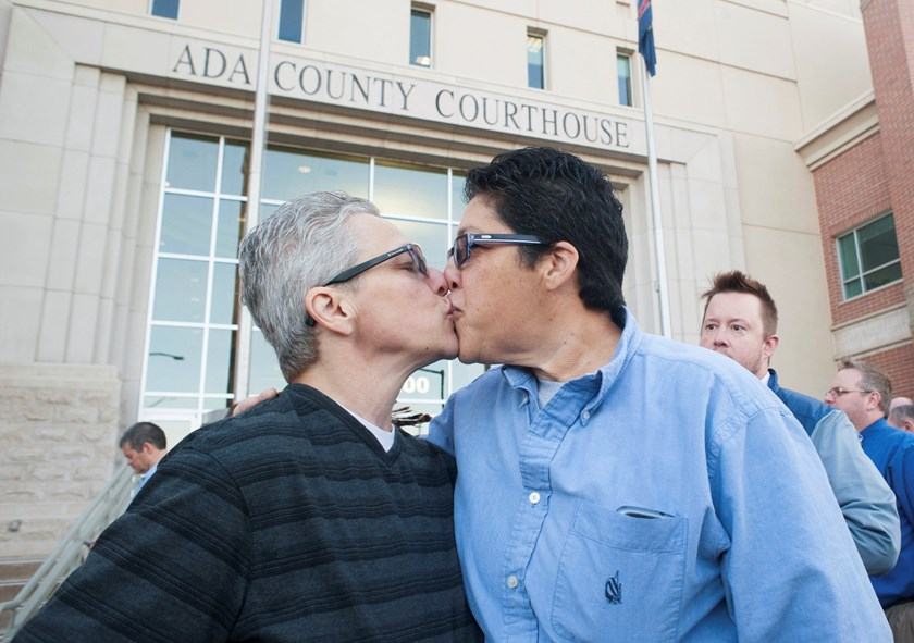 Jody (L) and Maria May-Chang greet as couples gather at the Ada County Courthouse to apply for same-sex marriage licenses, moments prior to U.S. Supreme Court Justice Anthony Kennedy's order blocking the action, in Boise, Idaho October 8. Photo credit: Re