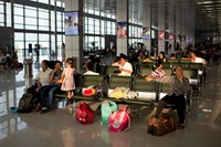 Passengers sit inside a departure lounge at Noi Bai International Airport in Hanoi in June 2014. Photo credit: Bloomberg
