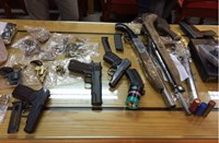 Drug and guns being seized during raid of a criminal gang led by Tran Hoang Nhat on October 21. File photo