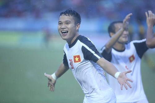 Thanh Nien Newspaper Vietnam's Phi Son celebrates a goal in their third place playoff match against Malaysia in Can Tho on October 28, 2014.