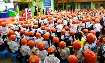 Children in Ho Chi Minh City receive helmets from the Asia Injury Prevention Foundation's Helmets for Kids program on Wednesday (October 29). Photo: Minh Hung