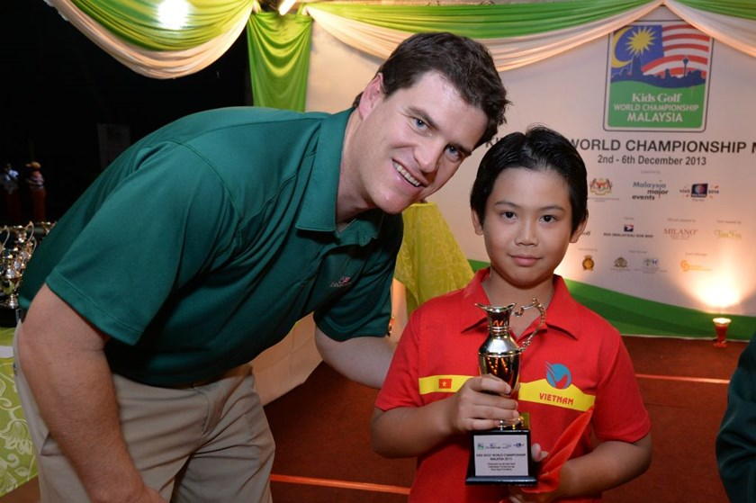 A file photo shows Vietnam's Andy Dang Quang Anh receiving award for coming second in eight-year-old category at the 2013 Kids Golf World Championship. The young golfer will represent Vietnam at the Kids Golf World  Championship 2014 to be held in Malaysi