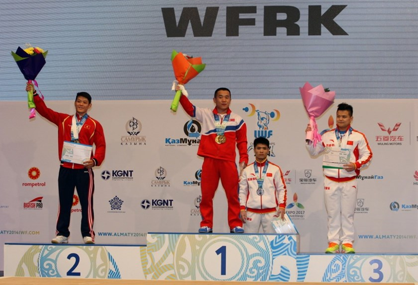 Thach Kim Tuan (L) on the podium for a silver in overall weighlifting at the 2014 IWF World Championships. Photo credit: IWF