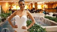 Truong Thi May competing at the Miss Universe 2013. Photo credit: Globaubeauties