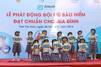 Children at the Ward 8C Primary School in Tra Vinh Province in a performance when they hold boards saying 'wear a helmet for not being regretful'. Photo credit: AIP Foundation