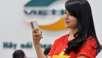 A woman with her smartphone at a Viettel shop. The military-owned company topped the list of largest tax payers in Vietnam this year. Photo credit: Viettel